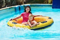 A mother and daughter enjoying a ride at Splash Country