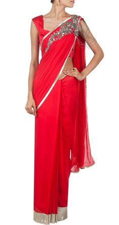 Elegant Gaurav Gupta red chiffon sari with brooch. Available from Pernia's Pop Up shop