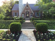 This Tudor home added curb appeal with the addition of a French Quarter lantern on a Yoke Bracket.