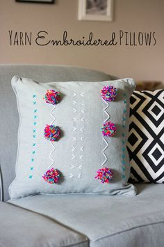 Pom-Pom Pillow - Decorate a plain pillow with yarn embroidery and pom-poms for a pop of fun color!