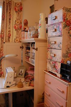 ♥♥ Shabby craft room. I love the way the drawers are covered! Great idea for inexpensive bland furniture. I've even done this with the cardboard storage drawers and contact paper.