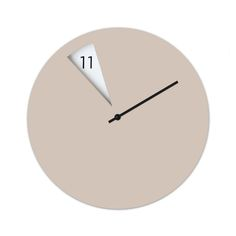 The Freakish wall clock in beige is available at Clippings. This modern wall clock is designed by Sabrina Fossi and will look absolutely stunning in any office or living room.
