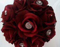 8 Red Real Touch rose bouquet with rhinestone embellishments and Swarovski crystals.  Ships in 1-2 weeks.  Available sizes:  7 toss bouquet  8 bridesmaid bouquet  10bridal bouquet  Flowers and handle color can be customized, please contact me with any questions or special requests so that together we can make a bouquet that is truly unique for your special day! Please allow 2-4 weeks for custom designs.  Thank you for visiting my page and congratulations on your engagement!  -Michele