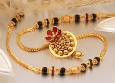 P N Gadgil & Sons - PNG: Buy Exclusive Gold Mangalsutra Designs in Pune, India. Available short daily use, Fancy Designer Mangalsutra with best price. Gold Chain Design, Gold Bangles Design, Gold Jewellery Design, Bridal Jewellery, Antique Jewellery, Indiana, Gold Mangalsutra Designs, Long Pearl Necklaces, Egyptian Jewelry