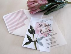Simple vellum and pretty pink floral wedding invitation
