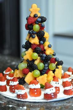 Christmas fruit tree with strawberry santas... don't forget the pompoms on the hats like I did.... lol