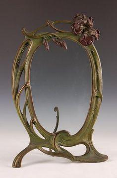 A CLASSIC CAST IRON ART NOUVEAU FRAME CIRCA 1900.