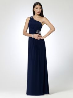 Matte jersey one shoulder dress with pearl and gem applique at shoulder and waist. Spaghetti corded back.