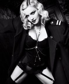 Madonna in a Christian Dior vintage jacket; Stella McCartney bra; Agent Provocateur waist cincher; La Perla briefs; and her own garter belt and rosary necklace. photographed by Luigi & Iango for Harper's Bazaar US, February 2017.