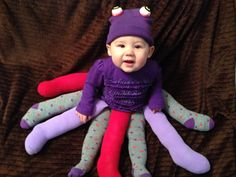 """Baby Octopus costume made from tights. Just cut the tights to length of your baby's legs, stuff with fluff and sew onto a strip of elastic to form a """"leg skirt"""". Put a pair of tights on the baby and slip on the leg skirt. Hot glue eyes to a winter hat. #DIY #babycostume"""