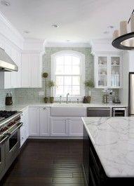 Luscious kitchens - mylusciouslife.com - White kitchen; dark wood floor, soft green subway tile