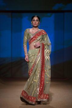 Ashima Leena green and red saree. More here: http://www.indianweddingsite.com/bmw-india-bridal-fashion-week-ibfw-2014-ashima-leena/