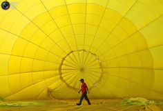 A handler walks inside a balloon during the Taiwan International Hot Air Balloon Festival in Luye Town, Taitung County, August 6, 2011. A total of 20 hot air balloon teams from Canada, Dubai, India, New Zealand, Switzerland, Thailand, the U.S. and Taiwan have been invited to take part in the fiesta. The festival is slated to run through August 31 at the Luye Gaotai area in the scenic park. REUTERS/Nicky Loh
