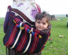 Mirza carrying baby Pari in one of these while he herds sheep...or walks around Moscow--