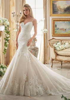 Alencon Lace Appliques on Tulle with Wide Scalloped Hemline Wedding Dress Designed by Madeline Gardner. Colors: White, Ivory, Ivory/Champagne