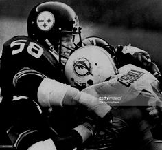 Jack Lambert of the Pittsburgh Steelers tackles Larry Csonka of the Miami Dolphins circa 1970s.