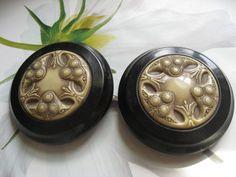 http://www.rubylane.com/item/465689-05966/Early-Plastic-Arts-Crafts-Buckle