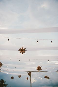Bistro Lights and Star Lanterns for a Starry Night Wedding Reception | Emily Blake Photography | http://heyweddinglady.com/starry-night-wedding-ideas-indigo-blue/