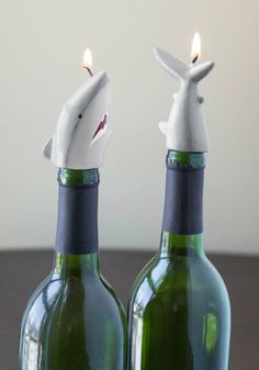 After savoring the last sip of Pinot Noir at your next dinner party, turn the empty bottles into fun nautical decor with these ferociously cute shark candles!