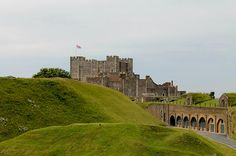 Dover Castle, atop the White cliffs of Dover is an ancient site, used by generations of the English, even before they would call themselves English.  Early groundworks are now grass covered mounds, with the normal keep in the background, and over to the right are World War Two gun emplacements and ammunition stores.