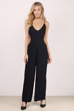 c3dd29e003fb The Jump On It Jumpsuit features a low neckline and revealing back