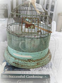 Love this round cage in shabby turquoise