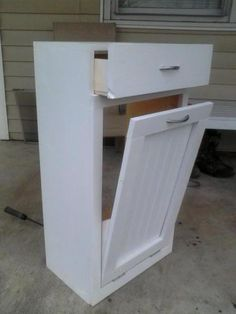 Tilt Out Trash Bin - it would need to be bigger but I love the idea of a drawer on top, good place to store the trash bags