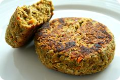 Vegie Burgers  90g rolled oats  2-3 slices grain bread  1/2 onion  1 large clove garlic  1 Tbs olive oil   1 carrot  1 big handful fresh parsley  1 can cannelini beans, drained and rinsed  1 egg  70g sunflower seeds, toasted  60g slivered almonds, toasted  1 Tbs olive oil  1 Tbs soy sauce  1 1/2 tsp chilli  1 tsp cumin  1 tsp oregano  salt and pepper