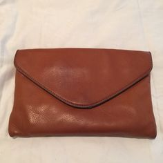 J. Crew Tan Envelope Bag Tan envelope bag with shoulder strap, inside and back pocket. Great construction and a perfect bag. Feel free to make me an offer. J. Crew Bags Clutches & Wristlets