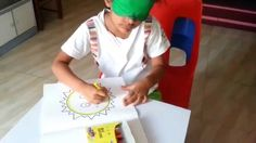 Brainy kid Painting with Blind Folded Eyes - Brain Child Learning India