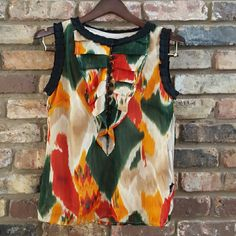 Multi-colored blouse Stunning blouse with an assortment of jazzy colors! Lots of pretty details! Enjoy! Tops Blouses