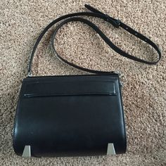 ❗️Alexander Wang Chastity Mini Shoulder Bag Hot little shoulder bag in great used condition. Has some signs of wear on body, and the strap doesn't stay closed on one side as shown in pic. I never had a problem with it staying on even though it was loose, but it can be fixed. Magnetic top closure. Authentic Alexander Wang. Price reflects wear. No trades, no pp, don't ask. Alexander Wang Bags Shoulder Bags