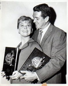 Doris Day and Rock Hudson display their plaques after being voted American's top male and female movie stars for the second year.