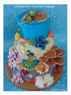 Coral reef and under water layers.top layer could be sand like an island. I like the anemone with the finding nemo fish in there! A more realistic turtle would be good though. Good Cake for you Pretty Cakes, Beautiful Cakes, Amazing Cakes, Ocean Cakes, Beach Cakes, Crazy Cakes, Fancy Cakes, Fondant Cakes, Cupcake Cakes