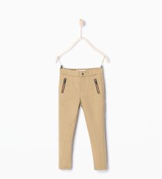 Image 1 of Zipped trousers from Zara