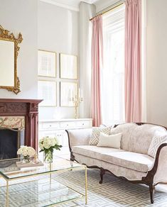 Love the French, antique-inspired details in this pastel-hued, feminine living room.