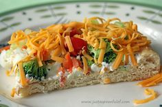 A healthy snack for the Super Bowl... Veggie Pizza. Preheat oven to 375 degrees. Spread (flatten) the crescent rolls on cookie sheet.Bake for about 10 minutes,until the crust is golden.Cool completely. Blend together the 16oz. cream cheese, 1 cup (light) mayonnaise, 1-3 Tbsps. milk 1 pkg. Hidden Valley Ranch Salad Mix Spread over the cooled crust, add veggies and cheddar cheese. Serve.