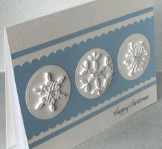 handmade Christmas card by PaperDaisyCardDesign ...pale blue and white ... three circles topped with ;quilled snowflakes ... delightfutl!