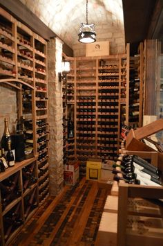 Unusual Florida Wine Cellars Construction Project Presents the Wine Bottles Cork First. The wine racks have a curved display feature that allows wine bottles to be displayed cork-first. See more photos at http://www.winecellarspec.com/remarkable-custom-wine-cellars-naples-florida-with-a-wine-tasting-room/.