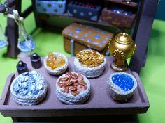 La mesa del cambista. Monedas, turquesas y ámbar