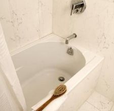 how to remove well-water stains from tub and shower easily....I haven't tried anything that is easy yet