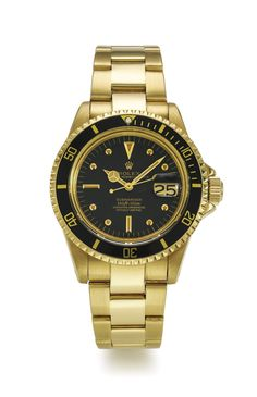 Rolex A YELLOW GOLD AUTOMATIC CENTRE SECONDS WRISTWATCH WITH DATE AND BRACELET REF 1680 CASE 2976240 SUBMARINER 660FT=200M CIRCA 1970 • cal. 1570 automatic movement, 26 jewels • black dial, applied luminous dot, baton, and dagger indexes, luminous Mercedes hands, magnified aperture for date • 18k yellow gold Oyster case, revolving black bezel calibrated for 60 units, screw-down crown protected by crown guard, and back • case, dial and movement signed • with an 18k yellow gold Rolex Oyster…