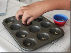 Muffin tins and tip pinch- Teaches fine motor skills. When working on developing a fine tip pinch, you have to make it happen by removing the option of a raking grasp. Learning Time, Preschool Learning, Early Learning, Motor Activities, Infant Activities, Pediatric Ot, Muffin Tins, Early Intervention, Baby Development