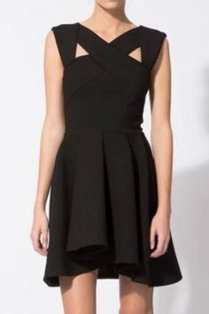 The mini dress featuring solid color. Cross collar With wide strap. Back zip closure. Pleated skirt.