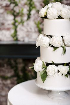 White wedding cake decorated with fresh white flowers