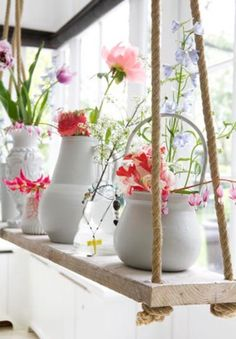 whimsy bouquets (bleeding hearts) pops of color in white pots.. on a swing