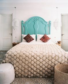 Painted wooden headboard + hanging Moroccan lanterns  Click through for more simple ways to transform your bed!