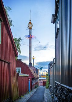 Alley from The Royal Djurgården in Stockholm, Sweden. Visible in the back is the amusment park Gröna Lund.