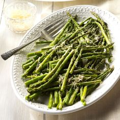 Parmesan Asparagus Recipe -Nothing could be more simple than this side dish. Since it has just four ingredients, I assemble it in no time, then pop it into the oven for about 15 minutes. It turns out perfect every time. —Mary Ann Marino, West Pittsburgh, Pennsylvania
