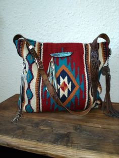Red and black saddle blanket bag with tassels, trinkets and leather handle Diy Saddle Blankets, Ethnic Bag, Western Purses, Boho Bags, Recycled Fashion, Cute Bags, Leather Handle, Leather Purses, Beautiful Bags